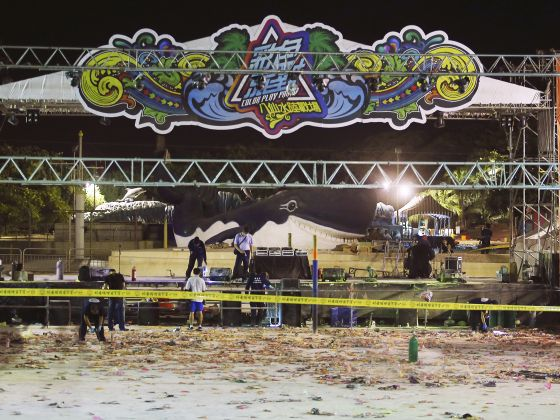 Police investigators inspect the stage area after an accidental explosion during a music concert at the Formosa Water Park in New Taipei City, Taiwan, early Sunday, June 28, 2015. Photo: AP