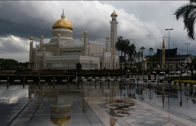 The Sultan Omar Ali Saifuddin Mosque is reflected in the pavement after heaving rains hit Bandar Seri Begawan