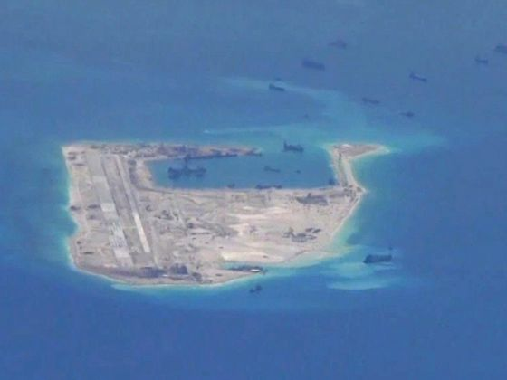 Chinese dredging vessels are purportedly seen in the waters around Fiery Cross Reef in the disputed Spratly Islands in the South China Sea in this still file image from video taken by a P-8A Poseidon surveillance aircraft provided by the United States Navy May 21, 2015. Photo: Reuters