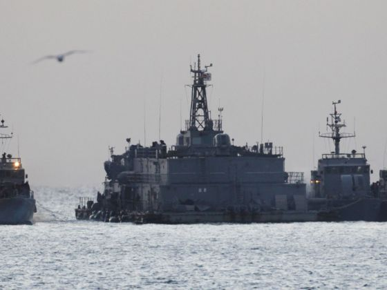A South Korean naval patrol ship (left) approaching its floating base off Yeonpyeong island in 2010. Reuters file photo
