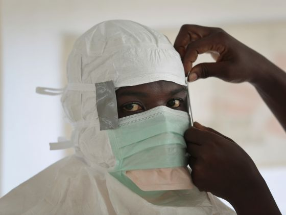 In this Sept 29, 2014, file photo a Medecins Sans Frontieres nurse gets prepared with Personal Protection Equipment before entering a high risk zone of MSF's Ebola isolation and treatment center in Monrovia, Liberia. Photo: AP