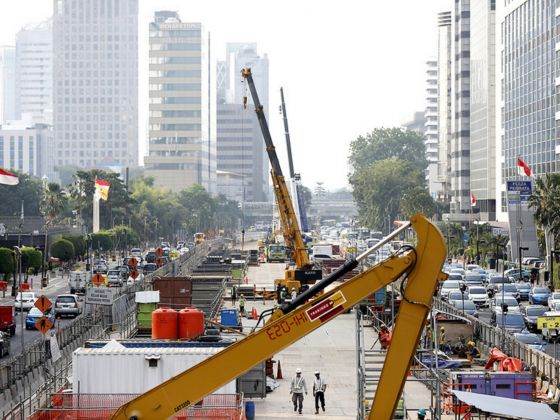 Workers building the new MRT line in Jakarta this month. An airport railway line in the capital is facing a delay amid bureaucratic infighting. Photo: Reuters