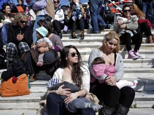 Women breastfeed their babies during a mass event in Athens last year to raise awareness among young mothers of the practice at the beginning of World Breastfeeding Week, which is an annual event held from August 1 to 7. File photo: Yorgos Karahalis