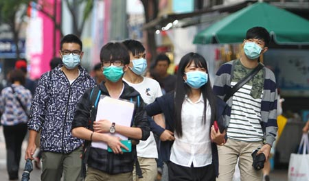 Koreans walking on Myeong-dong wear masks to avoid MERS.