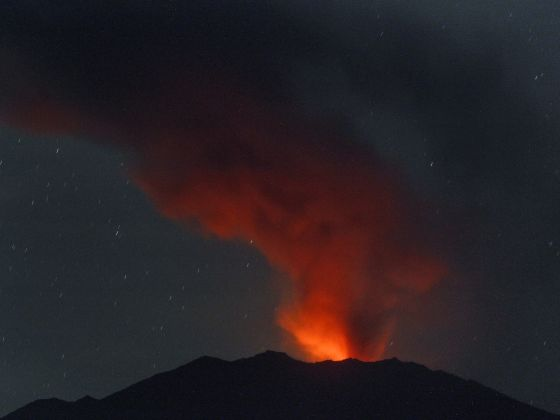 In this late Saturday, July 11, 2015 photo taken using long exposure, volcanic material spewed by Mount Raung glows from the hot molten lava in its crater as seen from Songgon, East Java, Indonesia. Photo: AP