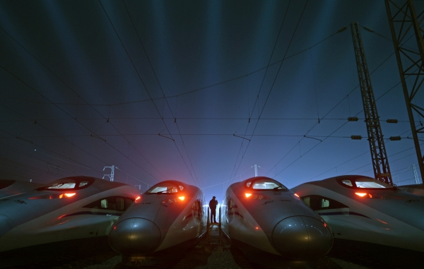 (Photo : REUTERS/Stringer ) A worker stands among CRH (China Railway High-speed) Harmony bullet trains at a high-speed train maintenance base in Wuhan, Hubei province.