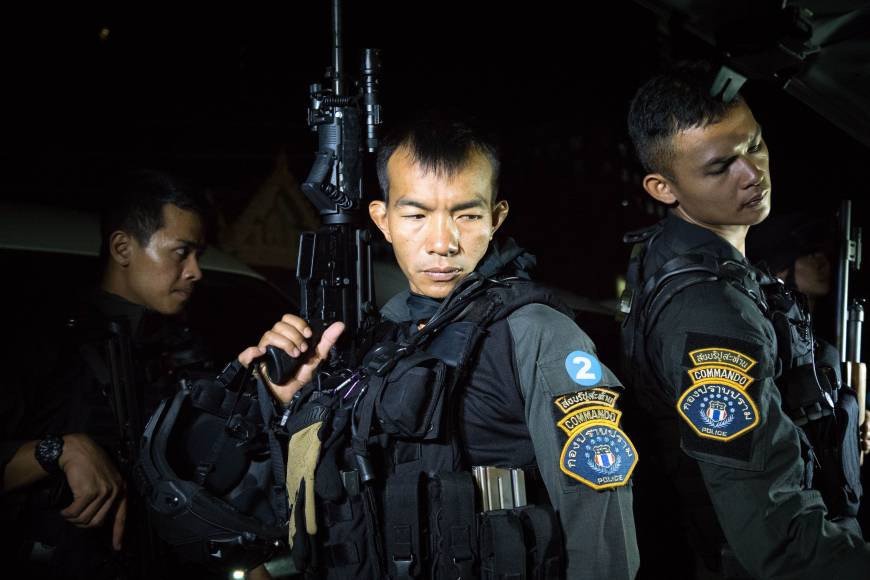 Members of Thailand's elite Crime Suppression Division police unit prepare to conduct a raid in Bangkok late last month. Known to tourists as laid-back and welcoming, Thailand is awash with firearms, and disputes are all too frequently settled with a bullet and a body. AFP