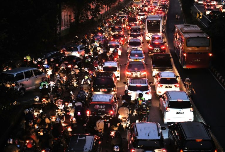 Motorists are stuck in a traffic jam on a main road in Jakarta on June 21 as they return home to break the fast during the holy Muslim month of Ramadan